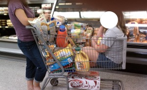 Tween riding in grocery cart